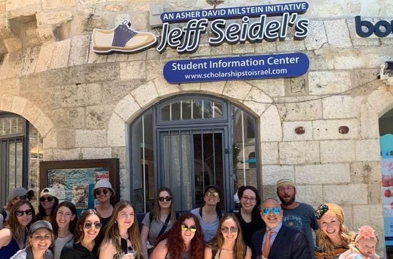 Jeff Seidel with students outside of his Student Information Center in Jerusalem.