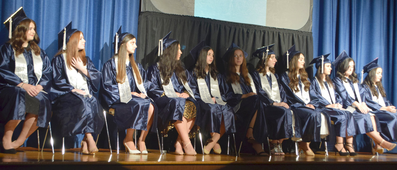 The first graduating class of the Shulamith High School for Girls in Cedarhurst, on Monday night. From left: Chana Adler, Hadassah Allman, Sara Berger, Yocheved Charlap, Shoshana Deil, Malka Guttman, Ariella Lax, Sela Pollack, Avigail Sassoon, Mindy Schreck and Nina Yurovsky.