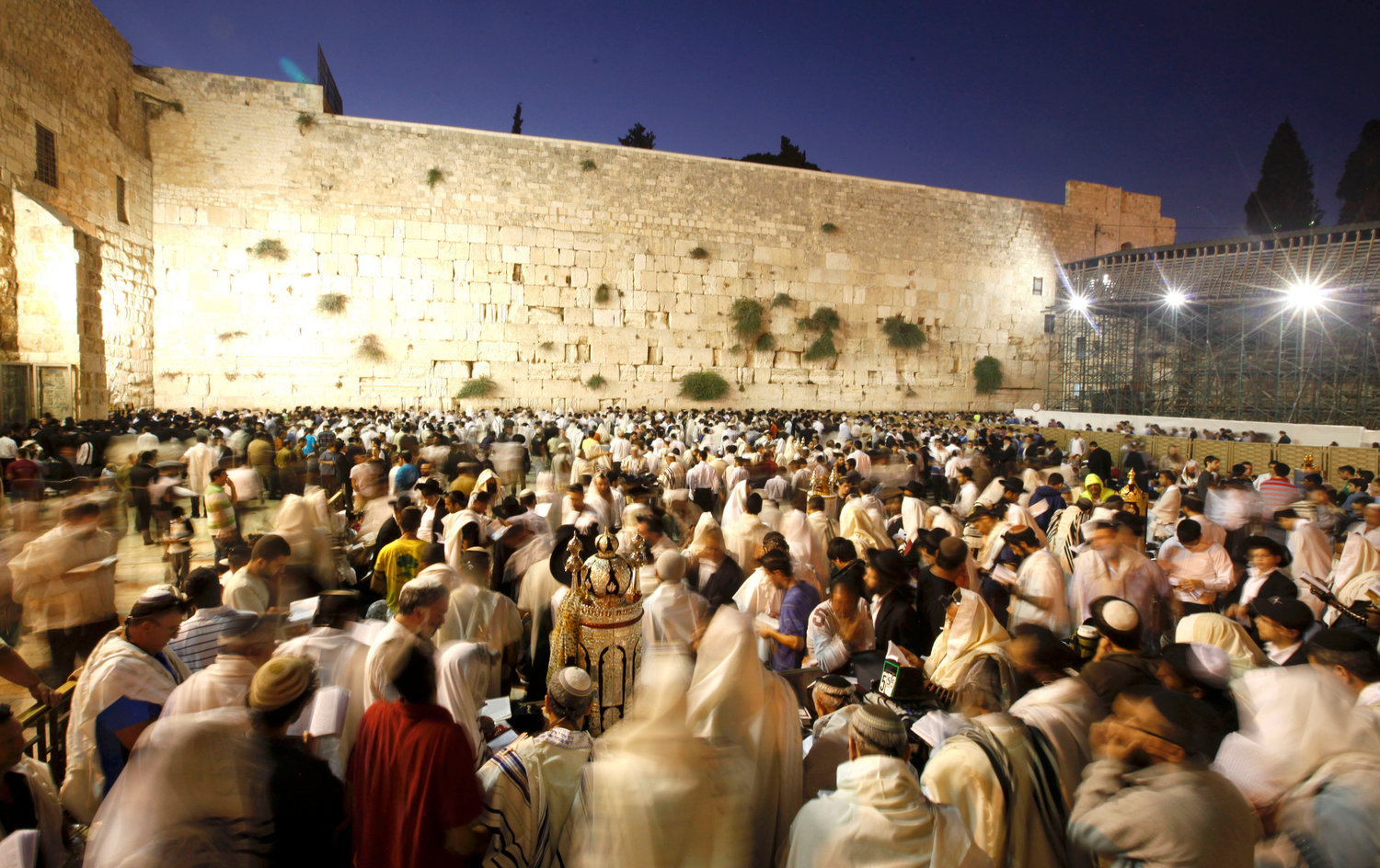 Worshippers at the Kotel early on Tisha B'Av morning in 2011.