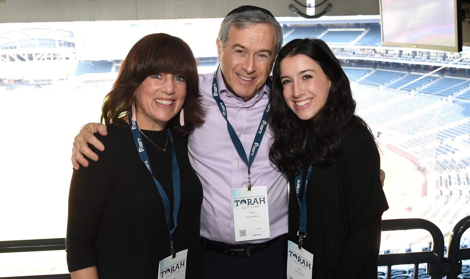 Among 2,5000 participants at the OU's third annual Torah NY, at Citi Field on Sunday: Risa, Yussi and Shira Sonnenblick of Lawrence.