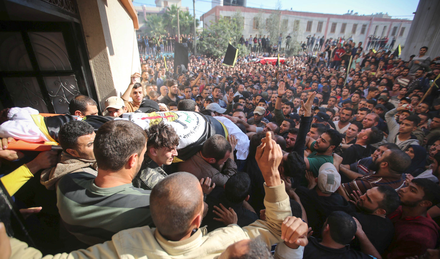 Mourners carry the body of Palestinian Islamic Jihad field commander Baha Abu Al-Atta during his funeral in Gaza City, after he was killed by an Israeli strike, in a targeted attack, on Nov. 12.
