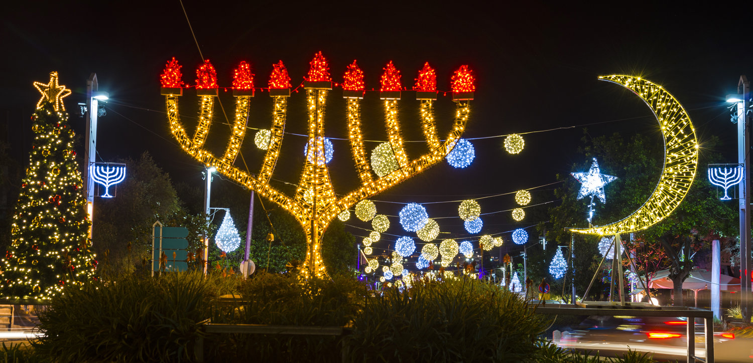 "Not a pretty picture: In Haifa, the ornaments of three religions celebrate the ""holiday"" season in the German Colony, a mixing of religions in a public space that our columnist finds objectionable."