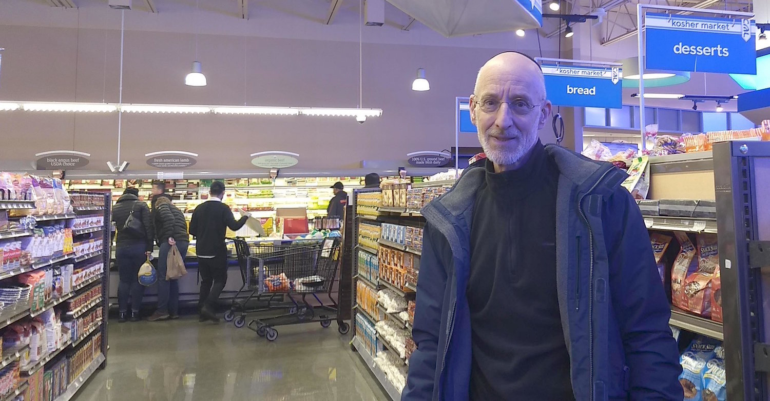Howard Rieger, former CEO of the Jewish Federations of North America, stands in a new kosher section of a supermarket on the outskirts of West Rogers Park.