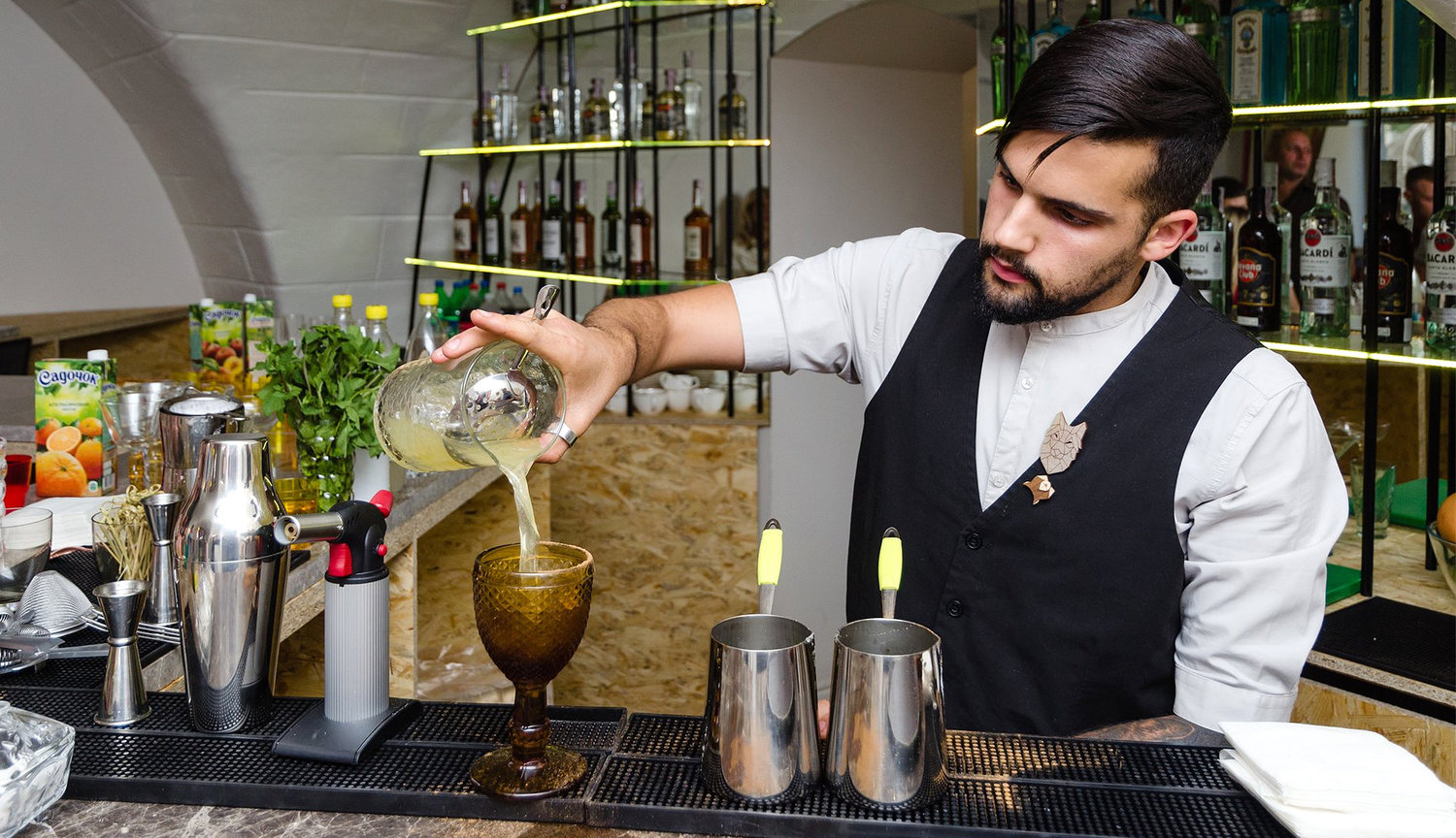 A bartender prepares a cocktail at Kosher Bar in Odessa.