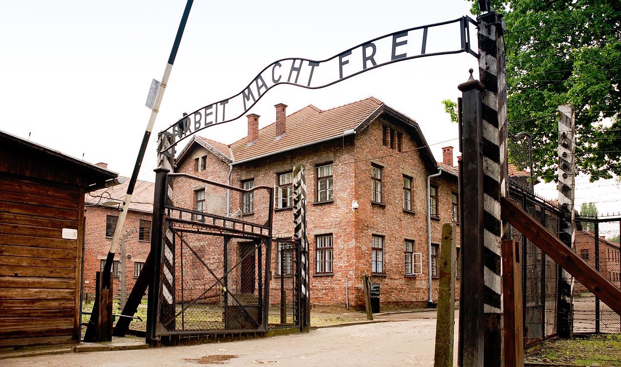 "The ""Arbeit Macht Frei"" gate at Auschwitz with the bitter irony of the German words: ""Work Will Set You Free."""