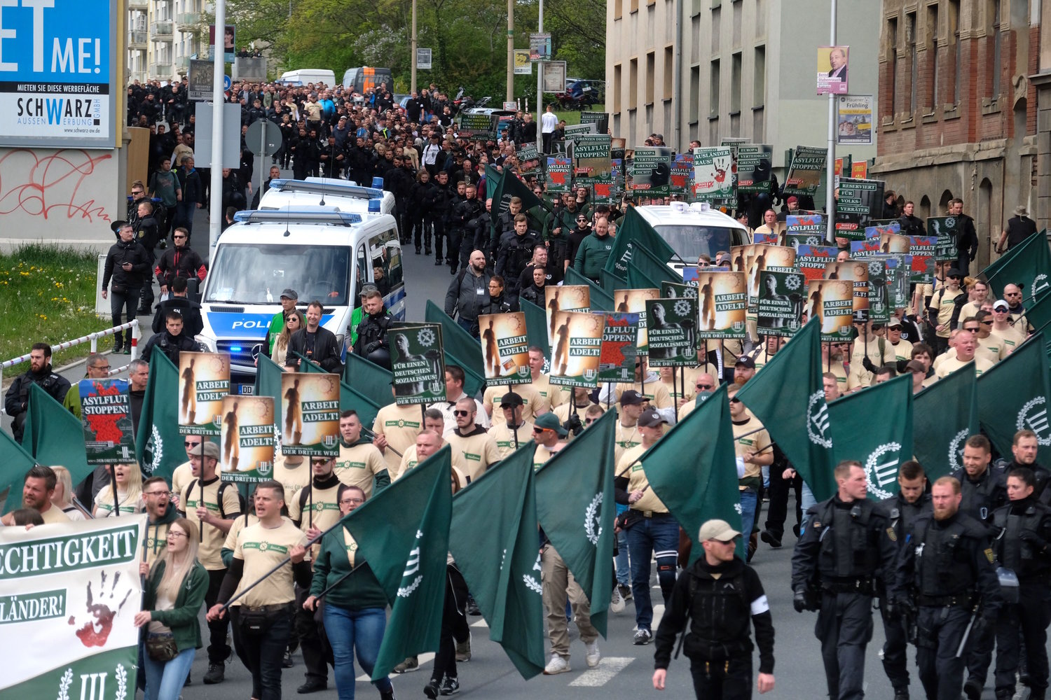 "Supporters of the ""Der Dritte Weg/Der III Weg"" (The Third Path/The III Path) far-right and neo-nazi party walk through Plauen, eastern Germany, during a demonstration on Labour Day, May 1, 2019."
