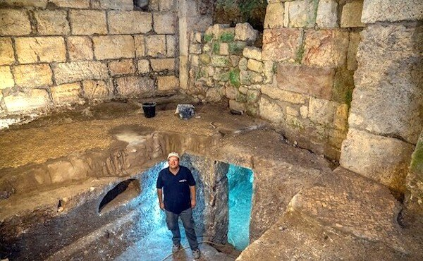 Dr. Barak Monnickendm-Givon at the new discovery near the Kotel.