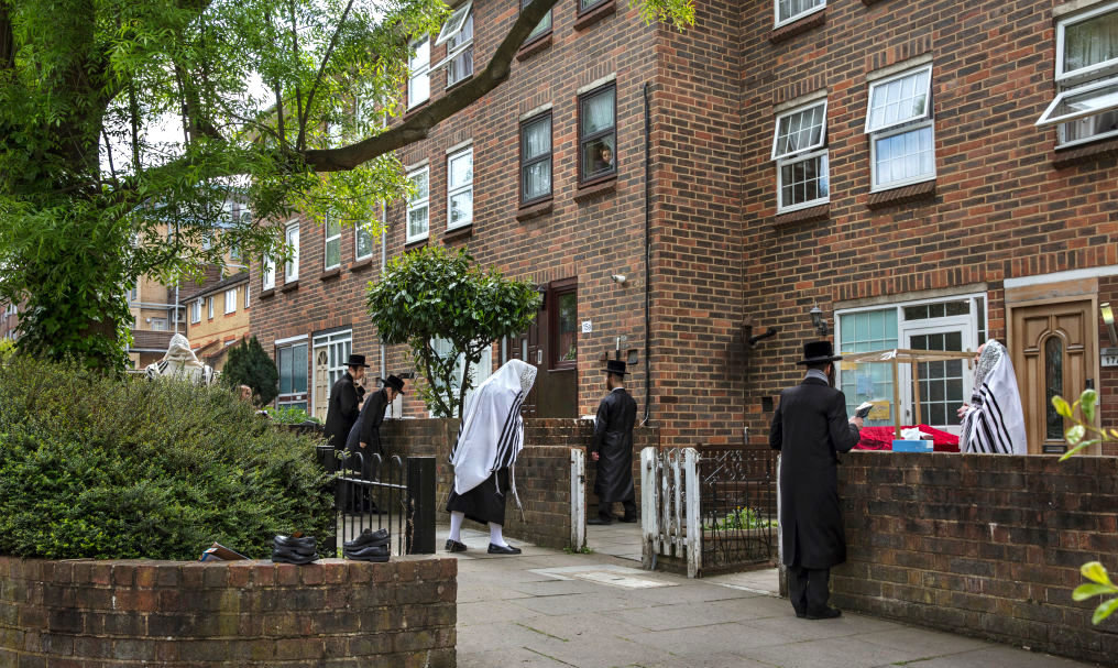 A prayer service outside a Stamford Hill home on April 25.