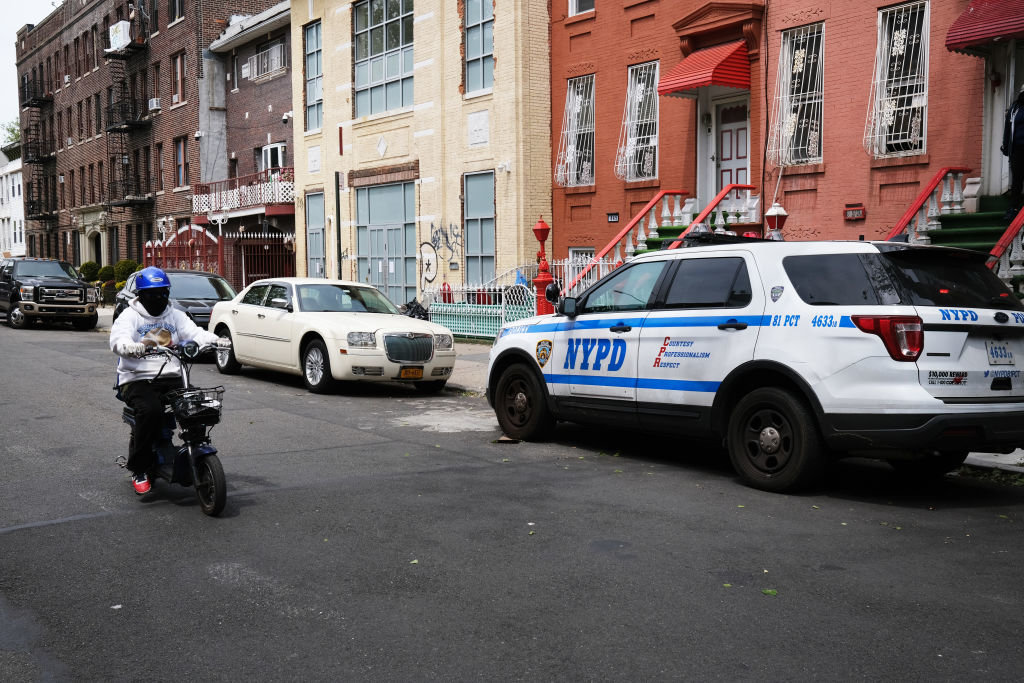 Police keep watch at a building used as a yeshiva in Brooklyn on May 19. Police broke up a session of about 60 students there.
