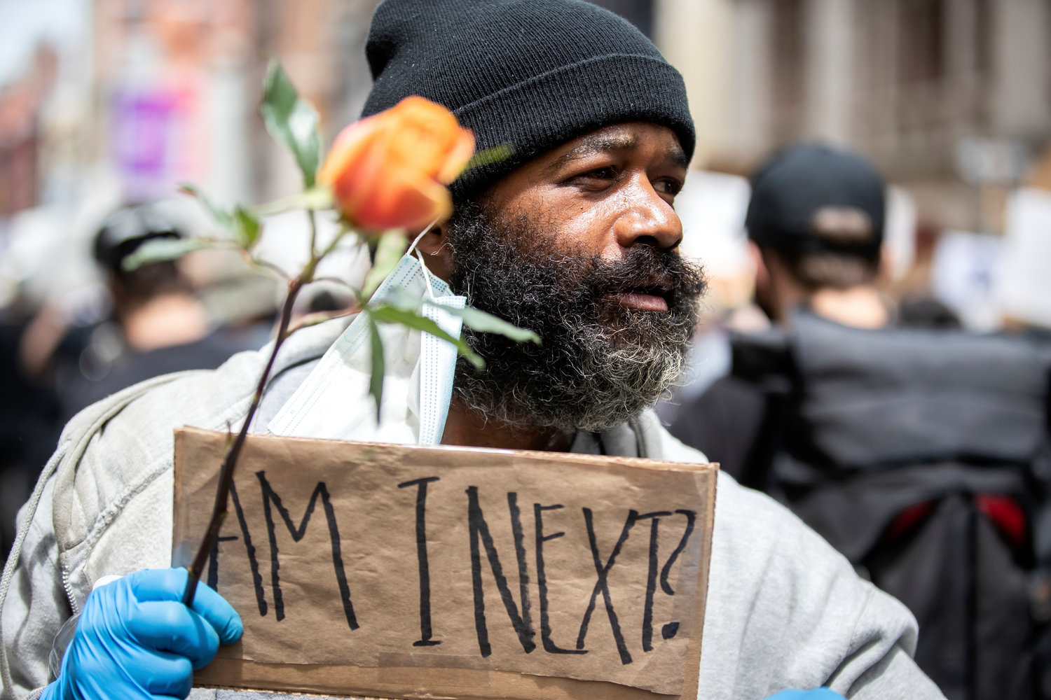 A man views a June 2 protest in New York City over the killing of George Floyd.