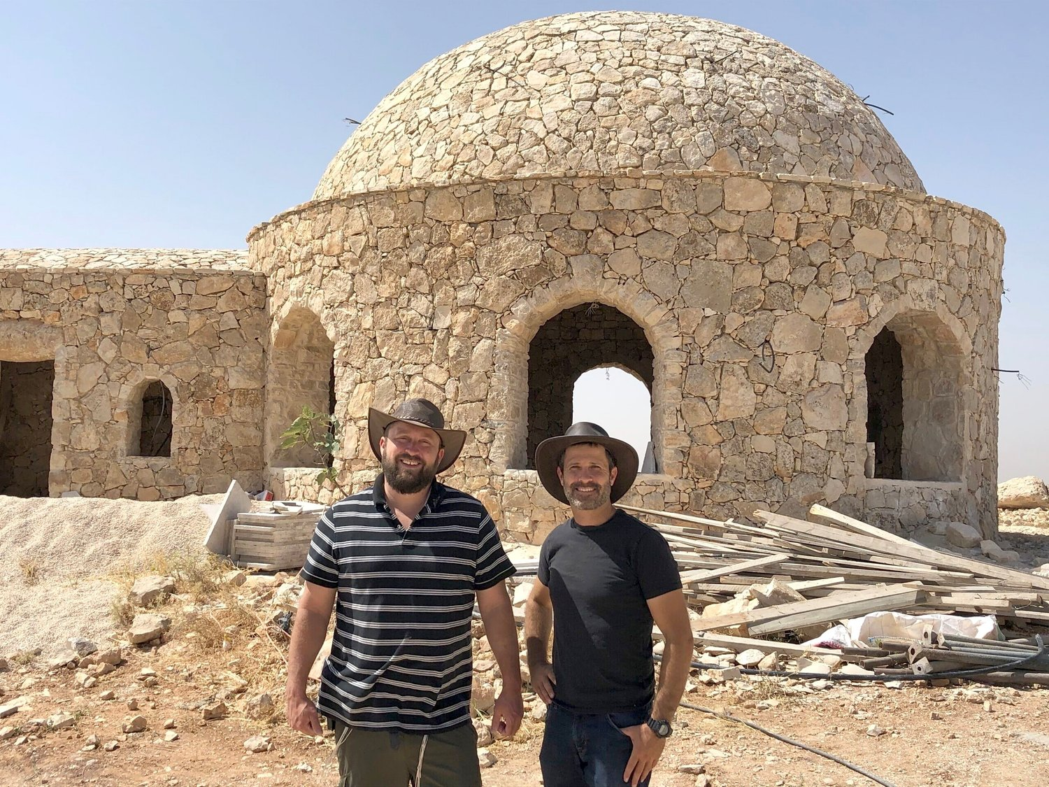 Ari Abramowitz (left) and Jeremy Gimpel in front of their house of worship on Arugot Farms.