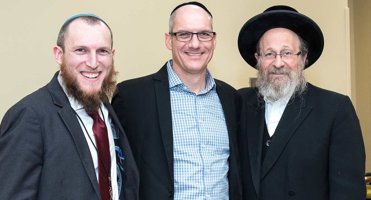 At a Chanukah benefit at Congregation Aish Kodesh in Woodmere, from left: Nevut founder and director Ari Abramowitz; Dr. Alfredo Nudman, and Rabbi Moshe Weinberger of Aish Kodesh. The concert featured Lazer Lloyd.