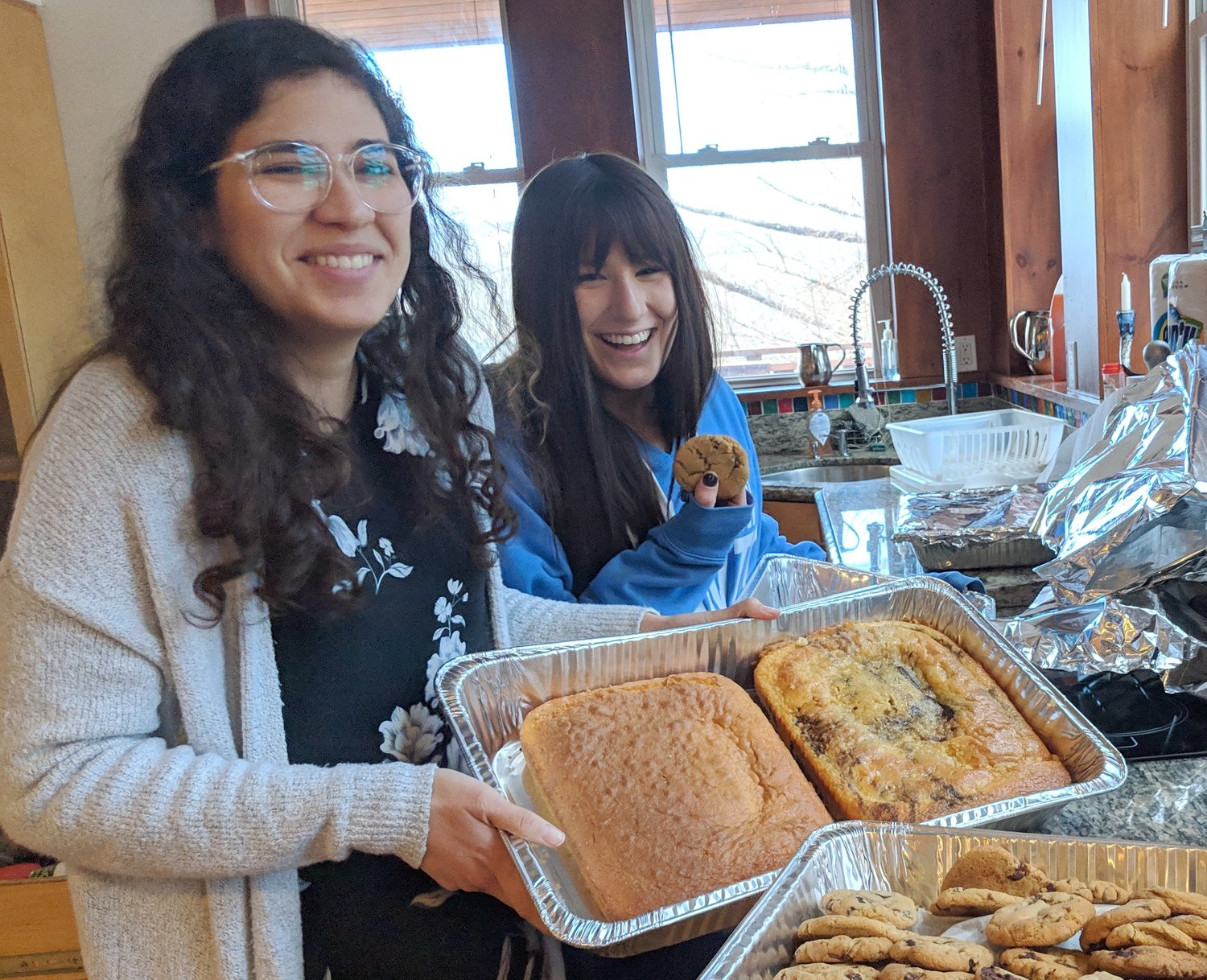 Long soldier veterans Esther Chait and Mattie Chein are baking cookies at a Nevut winter Shabbaton in Tannersville, NY.