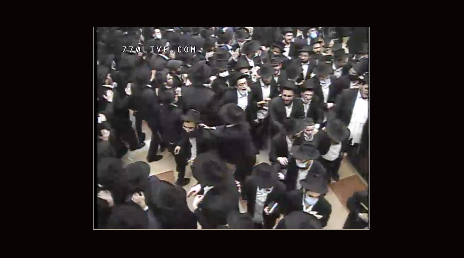 Unmasked men men, crowded into Chabad's main synagogue at 770 Eastern Parkway in Crown Heights, danced late into the night following Selichot services early on Sunday.