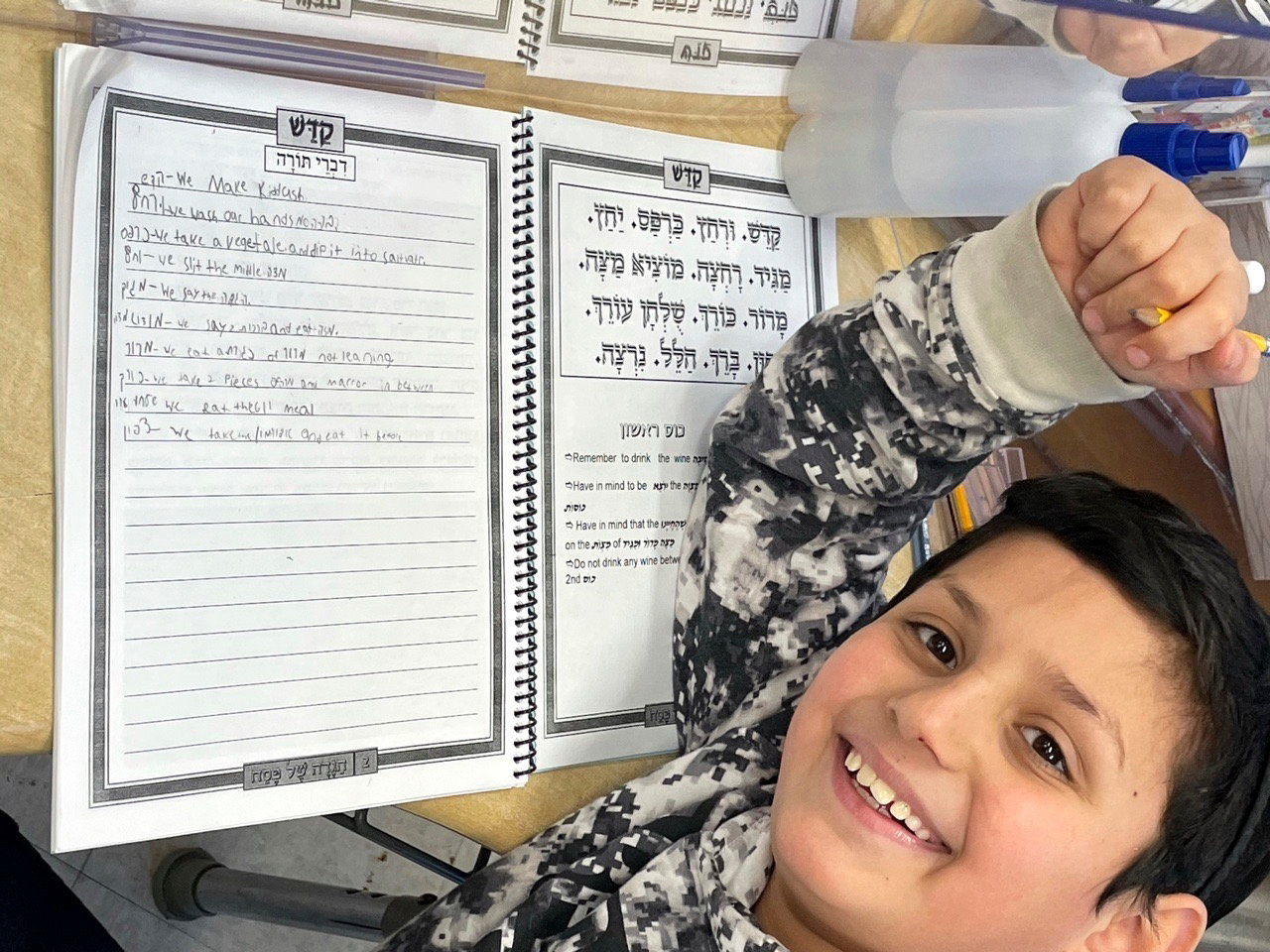 In CAHAL's grade 4-5 class at YOSS, boys learned divrei torah and wrote them in their Haggadahs to read at the Seder.