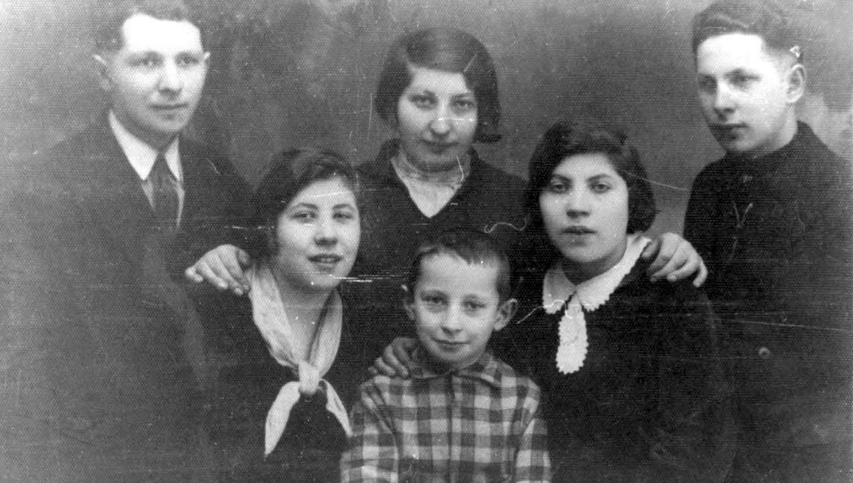 Six of the Bernstein siblings are pictured in Ylakiai, Lithuania, in February 1933. Top row, from left: Arye-Leib, Ida and Benzion; bottom row, from left: Rivka, Menachem and Hinda. They were all murdered in the Holocaust except for Ida, who immigrated to Eretz Israel (Mandatory Palestine) on Feb. 5, 1933, taking this photo with her.