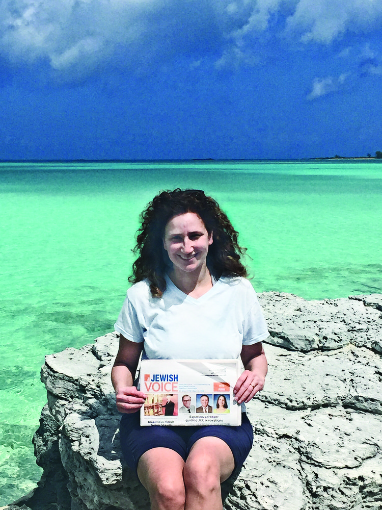 Ellen Jordan, president of Temple Sinai, is catching up with her reading in the Bahamas.