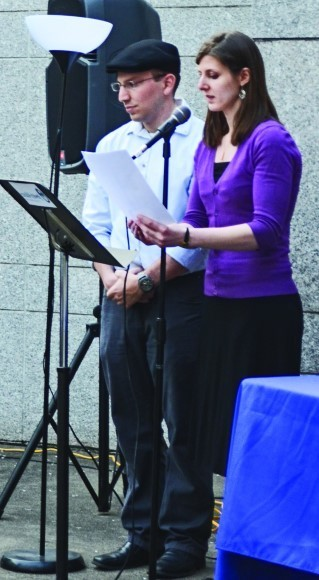 Israel shaliach Gilor Meshulam and Johanna Fleisher, vice president of (401)j, lead the Yom ha-Zikaron ceremony.