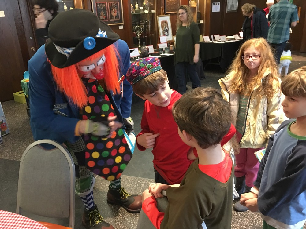 Sam Miller works his clown magic.
