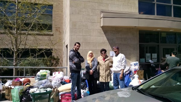 Temple Emanu-El and AHope representatives working together collecting donations for refugee families.
