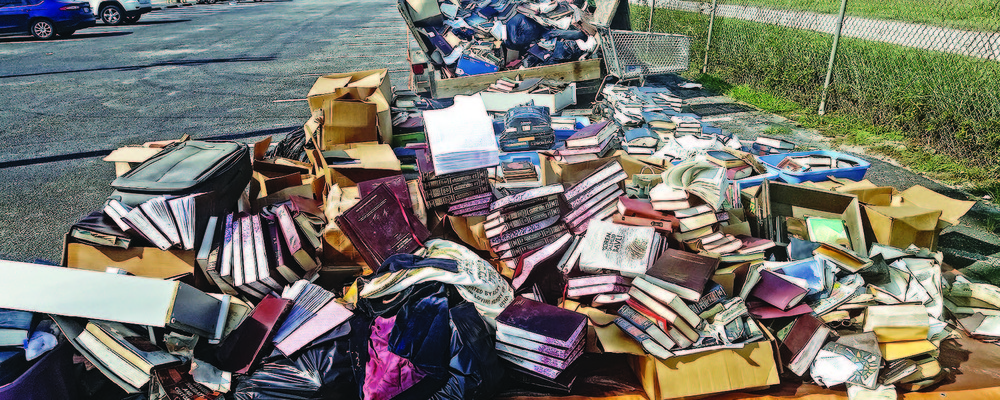 Piles of ruined books from United Orthodox Synagogues of Houston. The congregation lost many of its prayer books and replenished them through donations.