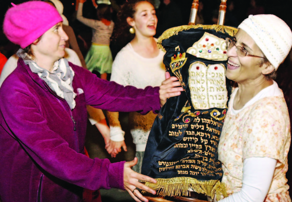 Orthodox standards about women carrying Torah scrolls have complicated their relationship to the holiday.