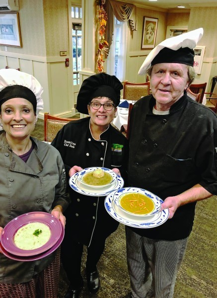 Left: Chef Phyllis Araffa holds a bowl of New England Fish Chowder. Center: Deb Blazer, executive chef, holds a bowl   of chicken soup. Right: Chef Tom Wilcox holds a bowl   of split pea soup.