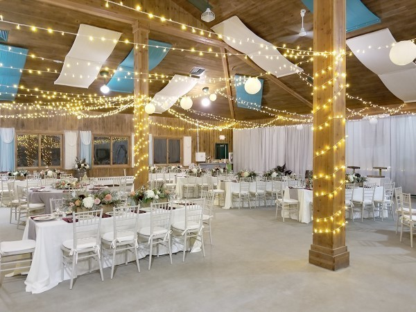 The JORI dining hall was transformed for the weddings. Parties of many sizes can be accommodated. Guests can stay in the cabins and use the camp facilities.