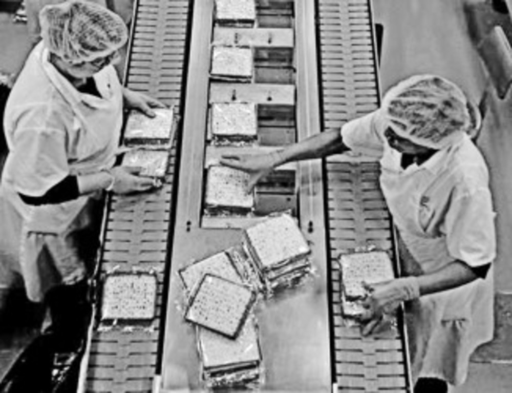 Fresh matzos are packaged on the production line at the Manischewitz manufacturing facility in Newark, N.J. Under strict rabbinical supervision at all times – over 1 million sheets of matzo are produced daily during Passover season.