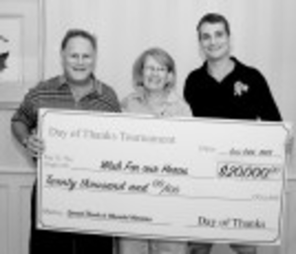 "Although the oversize check, above, says ""$20,000,"" this year's fundraiser brought in more than $25,000.  Buddy Trinkle, from left, Sharon Teich and Jeff Wells, from Wish for our Heroes, pose with the check."