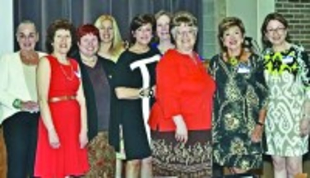 Some of Sisterhood's former leaders gather: Nancy Lovett, left, Nancy Riffle, Gaye Belsky-Gluck, Leslie Chazan, Sherry Levine Singer, Barbara Horovitz Brown, Carol Desforges, Phyllis Goldberg and Sherry Cohen at the centennial celebration.  /Elaine Sandy
