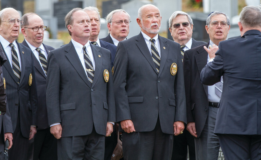 The classmates of Lt. Col. Jack Lustig from the West Point Class of 1957 sing the West Point alma mater near the end of the funeral service.