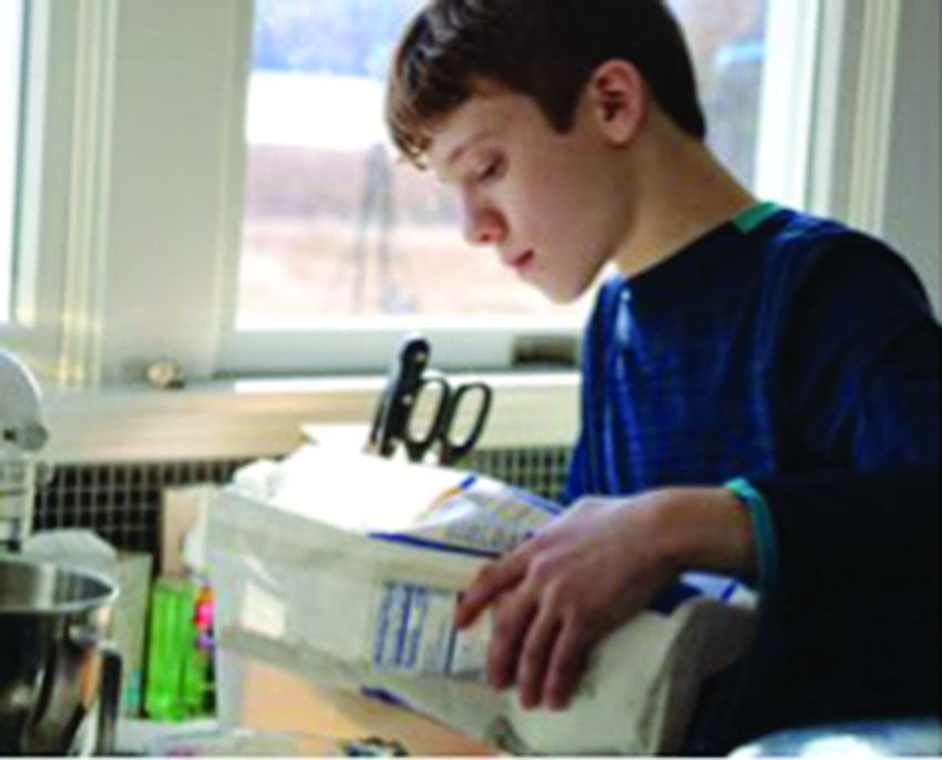 Sam Weiser makes cookies to raise money for textbooks   for students in Africa.