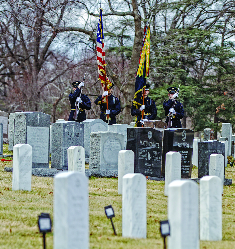 Soldiers salute Lt. Col. Jack Lustig during the   funeral service at Arlington National Cemetery.