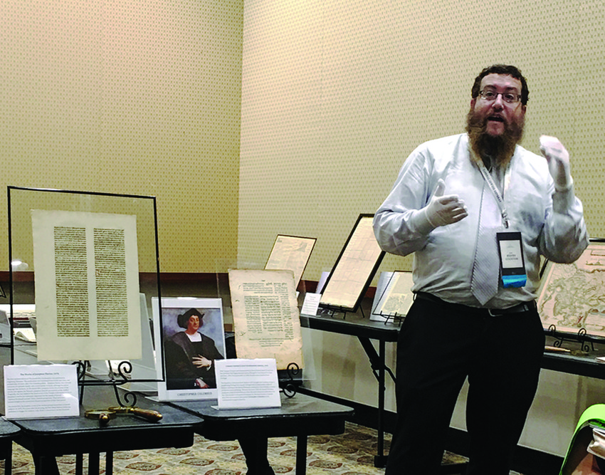 Reuven Goldstein, one of the speakers at the retreat,   with earliest examples of printed Hebrew.