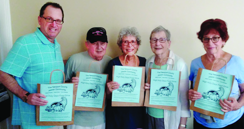 Left to right, Rabbi Marc Mandel, Dave Nathanson, Delia Klingbeil, Linda Nathanson and Irene Glasser with their food-drive shopping bags.