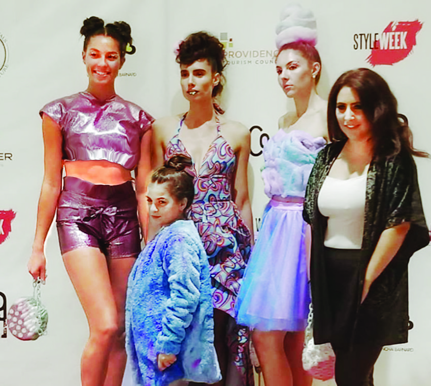 Ella Sinel, front, with  mentor, Arianna Buonanno, and the 3 models are wearing the clothes she designed   and helped to sew.