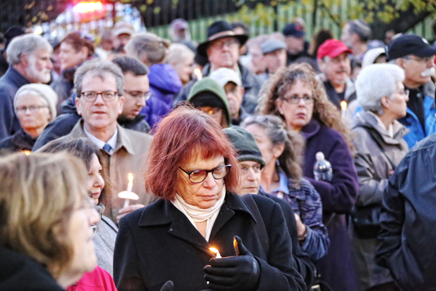 More than 1,000 people gathered in front of the Dwares Jewish Community Center in Providence to pray and listen to speeches in solidarity with mourners in Pittsburgh.