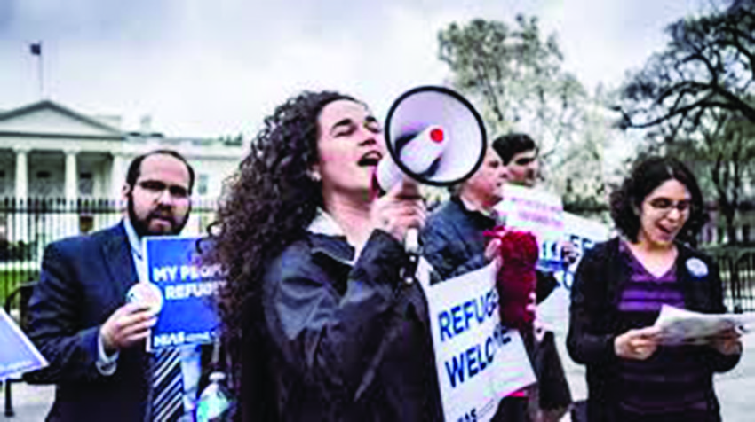 Activist Michele Freed, center, and other young professionals protest with HIAS   in front of the White House, March 1, 2017.
