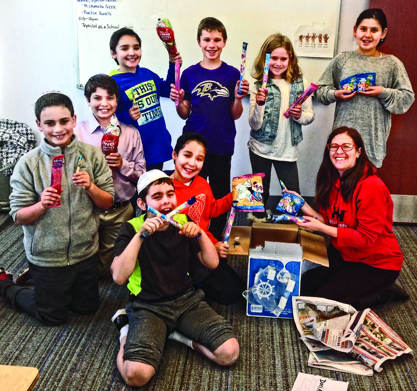 Students from Torat Yisrael's Cohen School enjoyed unpacking the treats from the Israel mystery box.