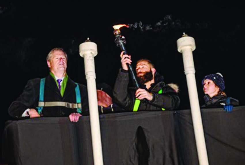 In Massachusetts, New England Patriots player Julian Edelman, above, lights the menorah in Copley Square (in the lift with him are Governor Charlie Baker and Emily Becker whose family are Chabad supporters).  And later, left, at the event that took place Dec. 6, Edelman is pictured with, (left to right)  Governor Charlie Baker, Rabbi Mayer  Zarchi of Chabad Boston,  Boston Councilman Josh Zakim, and Rebbetzin Chenchie Zarchi.