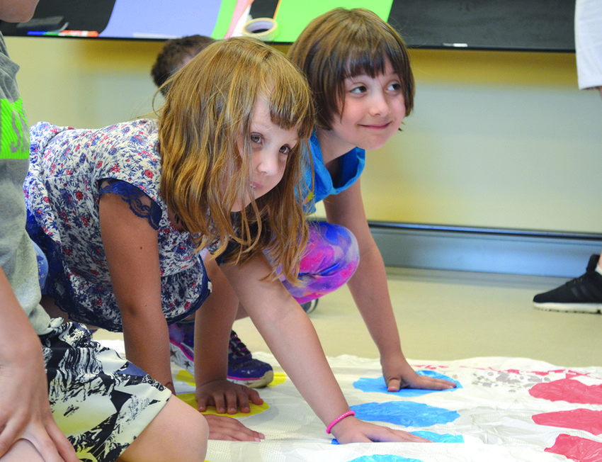 J-Campers enjoy a game of Twister in 2018.