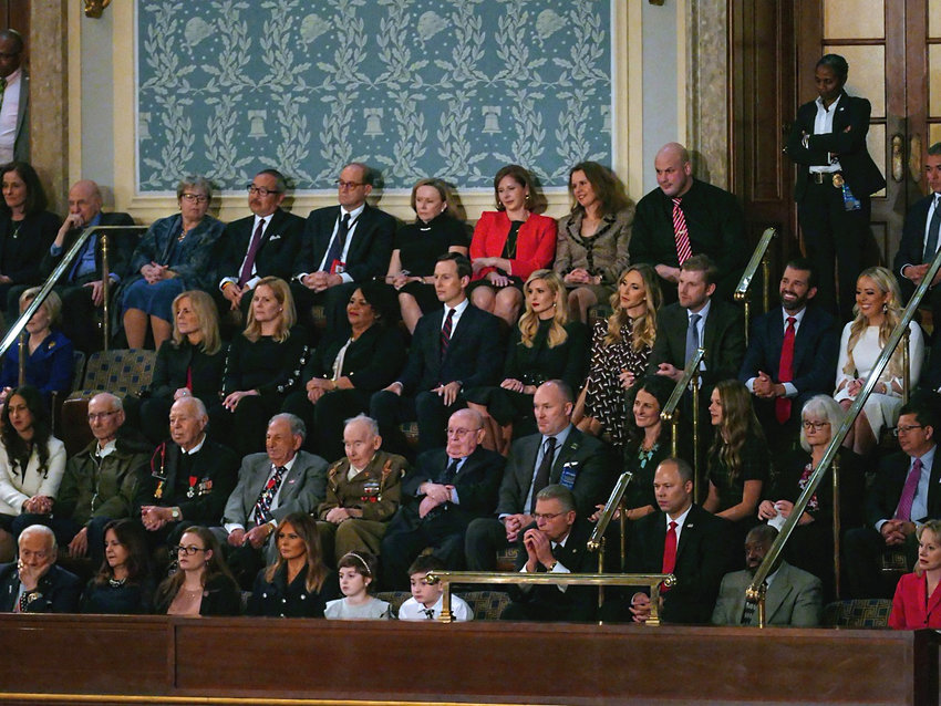 Listening to the State of the Union address in February 2019 are the first family and guests. Melania Trump is in the front row with Buzz Aldrin on her right. In the second row are WW II survivors. In the third row are the Kushners and President Trump's other children.