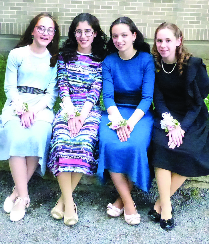 GRADUATING GIRLS sitting (left to right) are Leah Schwartz, Gittel Golden, Leah Zimmerman, Rivkah Taitelbaum. They will be attending the New England Academy of Torah next year.