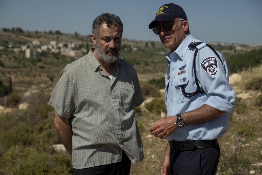 "Johnny Arbid, left, plays the grieving father of a slain Palestinian teen in ""Our Boys."""