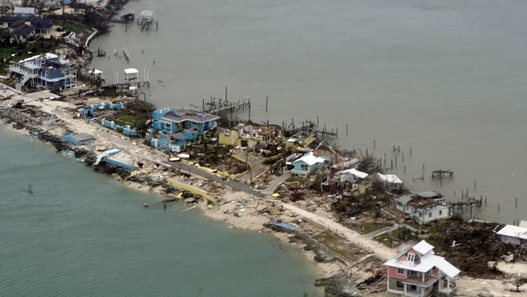 Overhead view of a row of damaged structures in the Bahamas.
