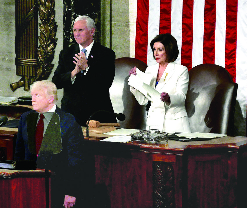 President Donald Trump at the end of his State of the Union address with Vice President Mike Pence and House Speaker Nancy Pelosi.