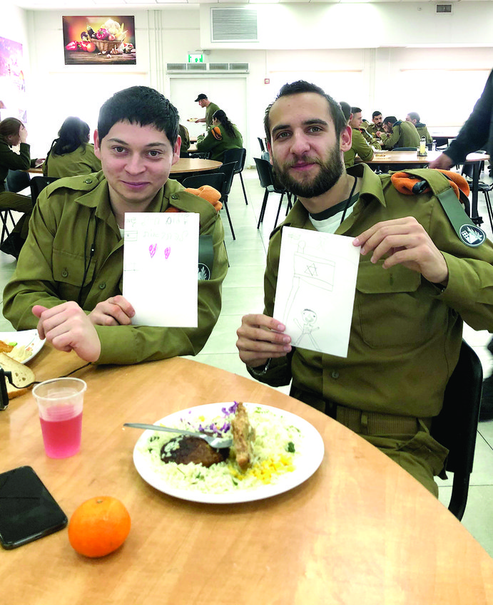 IDF soldiers display the cards from Providence.
