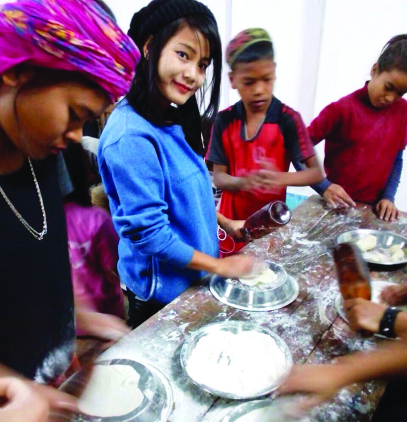 Indian Bnei Menashe Jews baking matzah in Churachandpur, India.