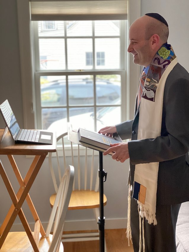 Rabbi Danny Burkeman has seen a big turnout at virtual services, which he leads from home.